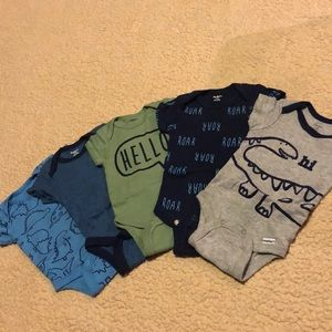 5 onesies in good condition